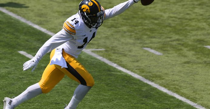 Iowa defensive back Desmond King celebrates after an interception at Kinnick Stadium on April 23, 2016. The defense beat the offense 20-18 in the spring game. (The Daily Iowan/ Alex Kroeze)