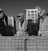 Three city workers stand behind flood barriers as the Cedar River continues to rise in Cedar Rapids on Monday, Sep. 26, 2016. The river is expected to crest at 23 feet on Tuesday, 11 feet above flood stage, as predicted by The National Weather Service while the flood record which was set in 2008 will remain at 31.12 feet.  (The Daily Iowan/Brooklynn Kascel)