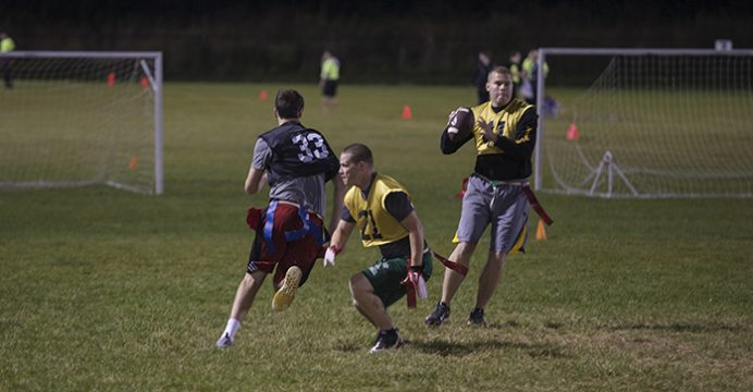 An intramural team plays capture the flag on the evening of Monday, Sep. 26, 2016. These intramural teams were started by the UI Police Department to develop a community policing strategy among students. (The Daily Iowan/Olivia Sun)
