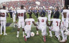 Nebraska coach backs protesting players