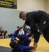 Brazilian Jiu-Jitsu practitioners spar during training at the Field House in Iowa City on Tuesday, Oct 18, 2016. Brazilian Jiu-Jitsu is a martial art and combat sport system that focuses on grappling and ground fighting. (The Daily Iowan/Ting Xuan Tan)