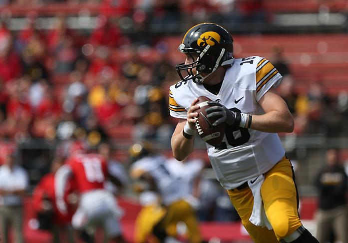 Wadley rushes for 170 yards and Iowa tops Purdue 49-35