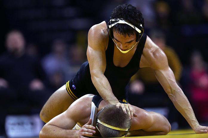 Iowa+141+pounder+Topher+Carton+wrestles+Michigan+States+Garth+Yenter+on+Saturday%2C+Dec.+6%2C+2014.+Carton+won+by+major+decision.+The+Hawkeyes+defeated+the+Spartans%3B+37-0.+%28The+Daily+Iowan%2FJoshua+Housing%29Topher