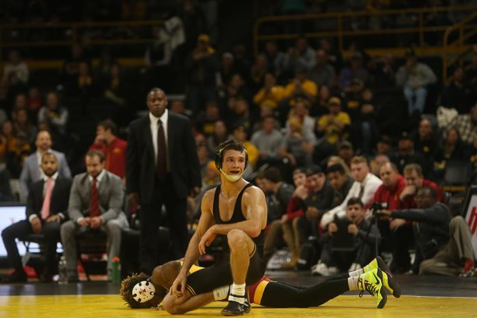 A whistle was blow during the 125-pounder match of Thomas Gilman and Iowa State's Markus Simmons during the Iowa-Iowa State match in Carver-Hawkeye Arena on Saturday, Dec. 10, 2016. Gilman defeated Simmons with a 19-4 tech fall in 5:09. Iowa defeated Iowa State, 26-9. (The Daily Iowan/Margaret Kispert)