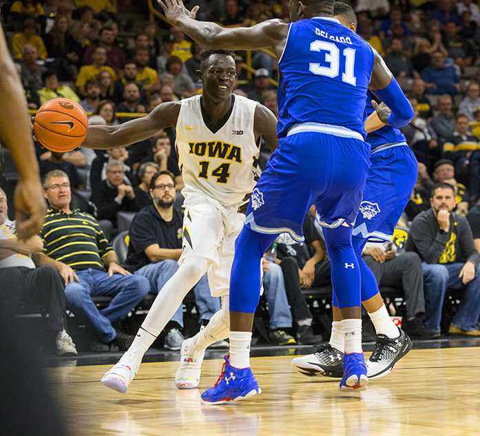 Iowa guard Peter Jok dribbles past Seton Hall forward Angel Delgado during a basketball game in Carver-Hawkeye Arena on Thursday, Nov. 17, 2016. The Pirates defeated the Hawkeyes, 91-83, in Iowa City. (The Daily Iowan/Joseph Cress)
