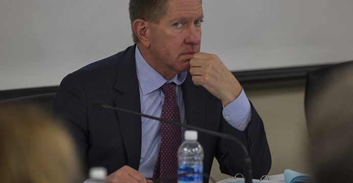 Regents President Bruce Rastetter looks away during a Board of Regents meeting on the University of Northern Iowa campus in Cedar Falls on Monday, Dec. 5, 2016. The regents voted to increase tuition by 2 percent for resident students with varying rates for nonresidents and graduates during their meeting. (The Daily Iowan/Joseph Cress)