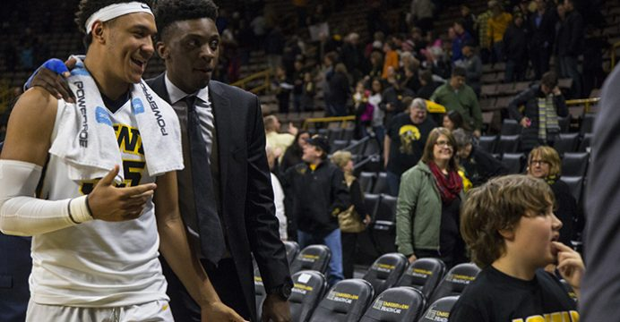 Iowa forward Cordell Pemsl walks off the court with Iowa forward Tyler Cook after a basketball game in Carver-Hawkeye Arena on Monday, Dec. 5, 2016. The Hawkeyes defeated the Hatters, 95-68, where Cook was sidelined due to a finger fracture. (The Daily Iowan/Joseph Cress)
