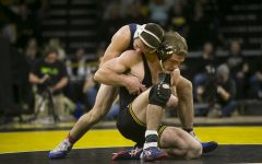 Iowa wrestling caught in tight matches with Penn State