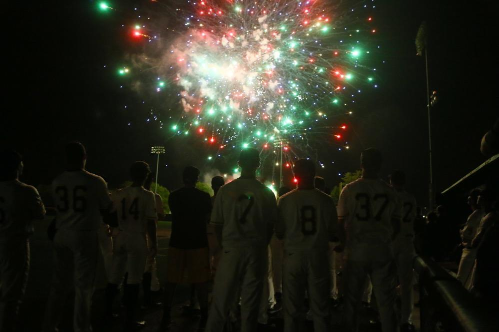 The Iowa team watch as fireworks end their season at home after the game between Omaha-Iowa at Duane Banks Field on Tuesday, May 16, 2017. The Hawkeyes pull off another comeback win with three runs in the 8th inning and two runs in the 9th inning for the 9-8 victory. (The Daily Iowan/ Alex Kroeze)