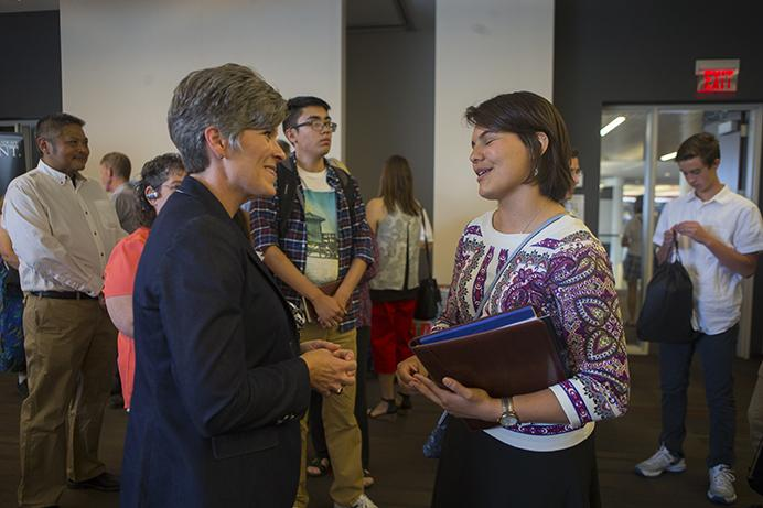 Sen.+Joni+Ernst%2C+R-Iowa%2C+speaks+to+a+student+during+a+US+Service+Academy+Open+House+in+the+Cedar+Rapids+Public+Library+on+Saturday%2C+June+24%2C+2017.+Ernst+met+with+prospective+military+families+and+protesters+alike+to+answer+questions+both+on+and+off+par+with+the+event.+%28Lily+Smith%2FThe+Daily+Iowan%29