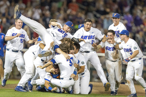 Florida celebrates after defeated LSU in Game 2 of the NCAA baseball College World Series finals, Tuesday, June 27, 2017, in Omaha, Neb. Florida won 6-1 to sweep the series. (Brendan Sullivan/Omaha World-Herald via AP)/Omaha World-Herald via AP)