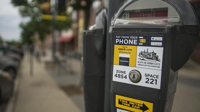 A+parking+meter+with+Passport+Parking+software+is+seen+on+Iowa+Avenue+on+Wednesday%2C+June+14%2C+2017.+Passport+Parking+is+an+app+designed+so+users+may+pay+for+parking+with+the+use+of+their+phone.+%28The+Daily+Iowan%2FBen+Smith%29