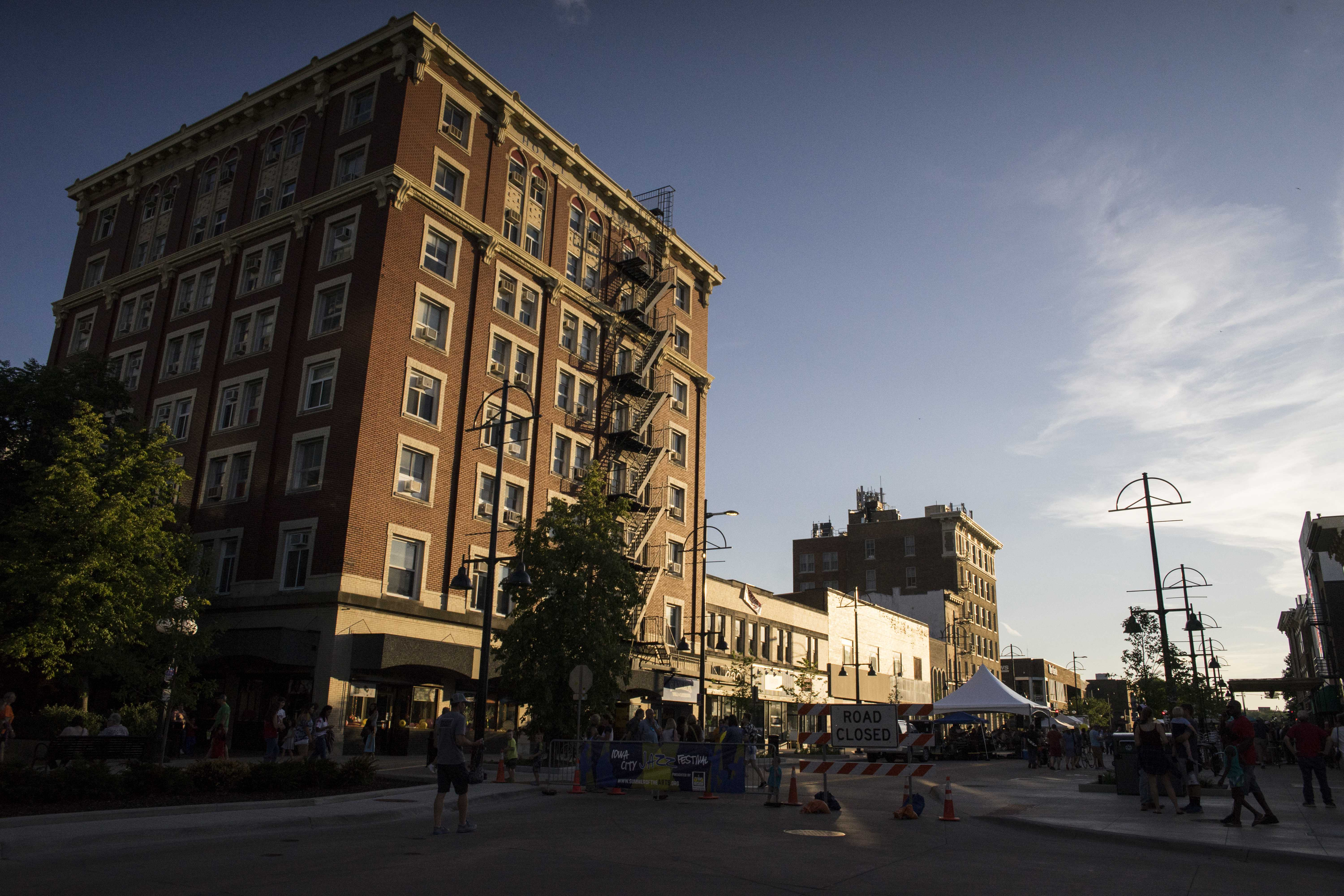 The Jefferson Building on Washington St. is seen during Jazz Fest on Sunday, July 2. This is within the Iowa City Downtown District, which held an event Thursday morning, discussing the continual progress being made in the downtown area. (Ben Smith/The Daily Iowan)