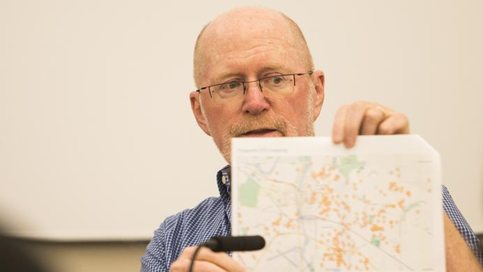 Iowa+City+Mayor+Jim+Throgmorton+holds+up+a+map+charting+police+responses+to+firework+calls+during+a+joint+entity+meeting+in+the+county+Health+and+Human+Services+Building+on+Monday.+Throgmorton+said+the+city+had+spent+more+than+100+hours+responding+to+453+fireworks+calls+as+of+July+8.+%28Joseph+Cress%2FThe+Daily+Iowan%29