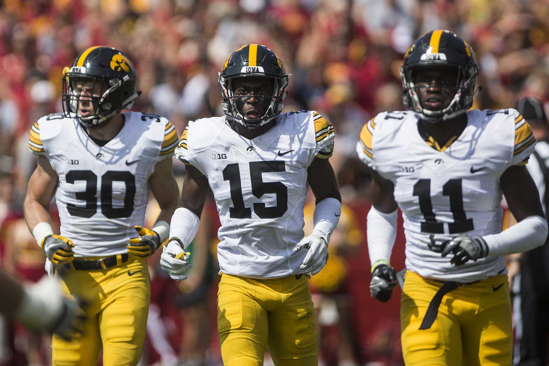 Iowa's Jake Gervase (30), Joshua Jackson (15), and Michael Ojemudia (11) run off the field during the game at Jack Trice Stadium on Saturday, Sept. 9, 2017.  (Ben Smith/The Daily Iowan)