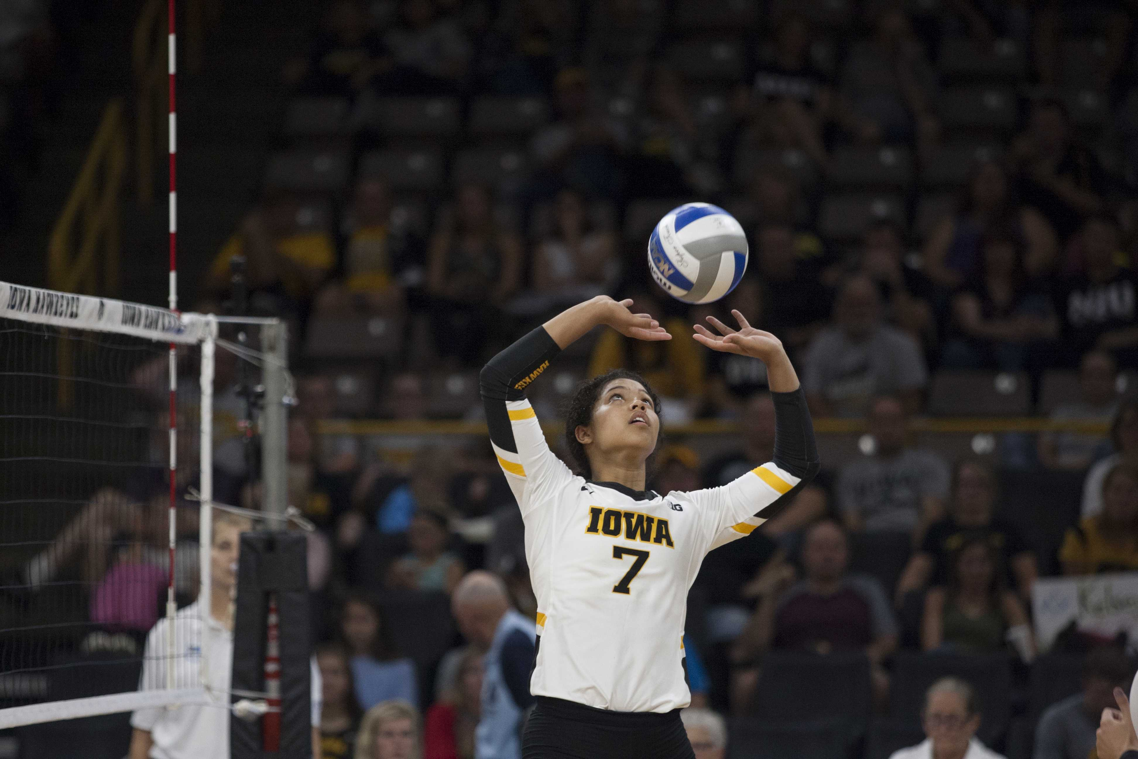 Brie Orr sets the ball up for a spike. Hawkeyes defeat the Huskies in volleyball winning the first three games. The game against Northern Illinois University took place at Carver Hawkeye Arena on September 9, 2017. (Ashley Morris/The Daily Iowan)