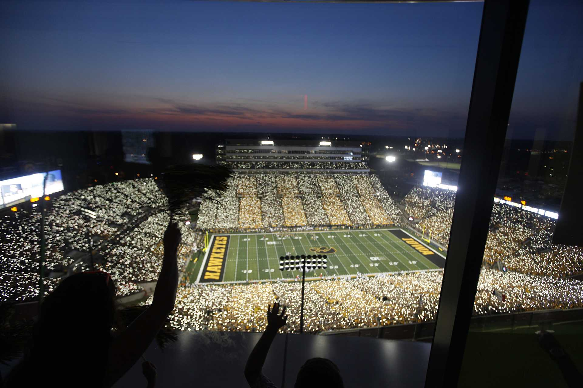 Fans at Kinnick wave to the children and their families at the UI Stead Family Children's Hospital in Iowa City Saturday, Sep. 23, 2017. (Paxton Corey/The Daily Iowan)