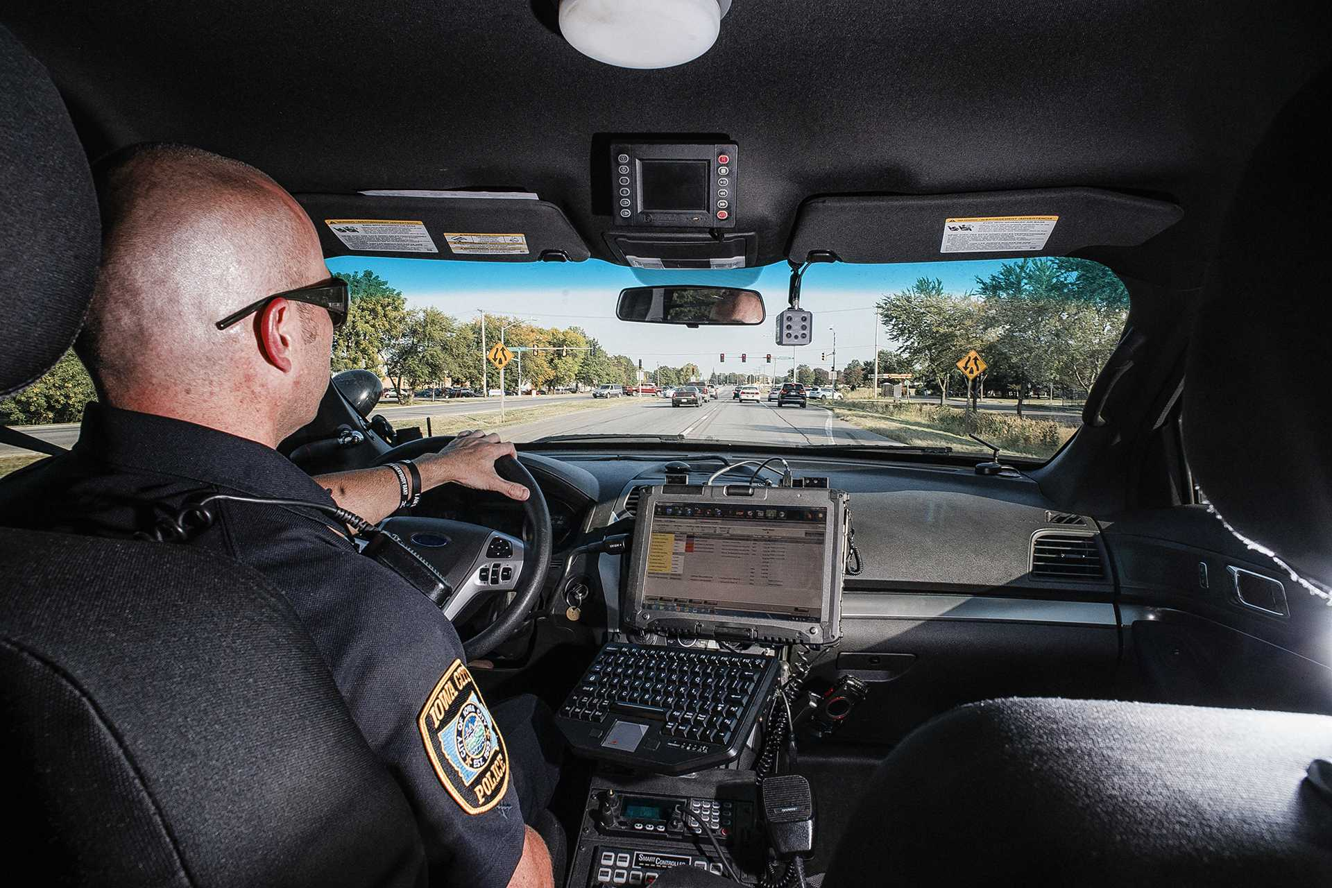 Sgt. Derek Frank of the Iowa City Police Department patrols on Highway 6 on Wednesday, Sept. 13, 2017. Sgt. Frank has been serving with the ICPD for 19 years. (James Year/The Daily Iowan)