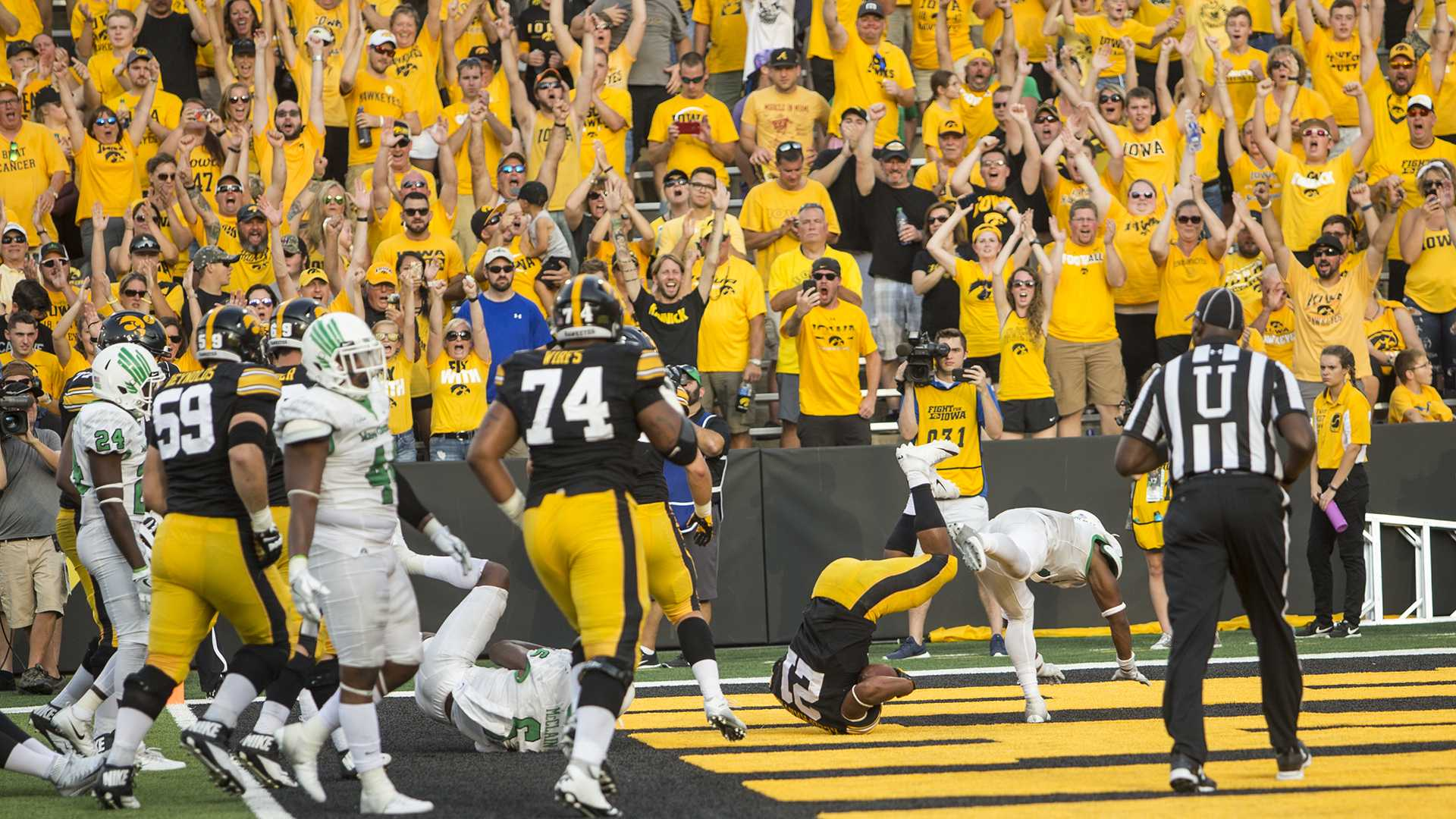 Iowa fan's celebrate after Ivory Kelly-Martin scores a touchdown during the game between Iowa and North Texas at Kinnick Stadium on Saturday Sept. 16, 2017. Iowa won 31-14. (Nick Rohlman/The Daily Iowan)