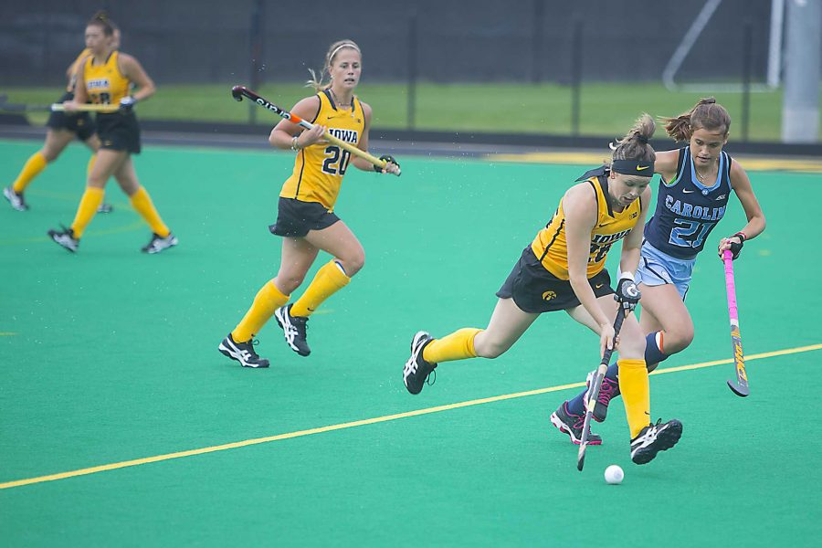 Iowa%27s+Madeleine+Murphy+%2826%29+runs+from+UNC%27s+Eva+Smolenaars+%2821%29+during+a+field+hockey+game+during+the+Big+Ten%2FACC+Challenge+at+Grant+Field+in+Iowa+City+on+Sunday%2C+Aug.+27%2C+2017.+The+Hawkeyes+fell+to+the+Tarheels%2C+3-0.+%28Lily+Smith%2FThe+Daily+Iowan%29