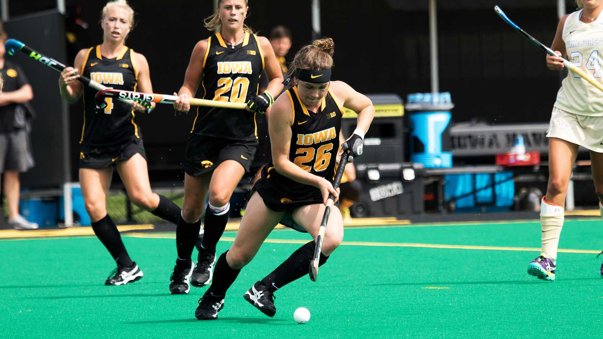Iowa's Madeleine Murphy plays the ball during the Iowa vs. Wake Forest field hockey match on Saturday, August 26, 2017. Wake Forest defeated Iowa by a final score of 3-2. (David Harmantas/The Daily Iowan)
