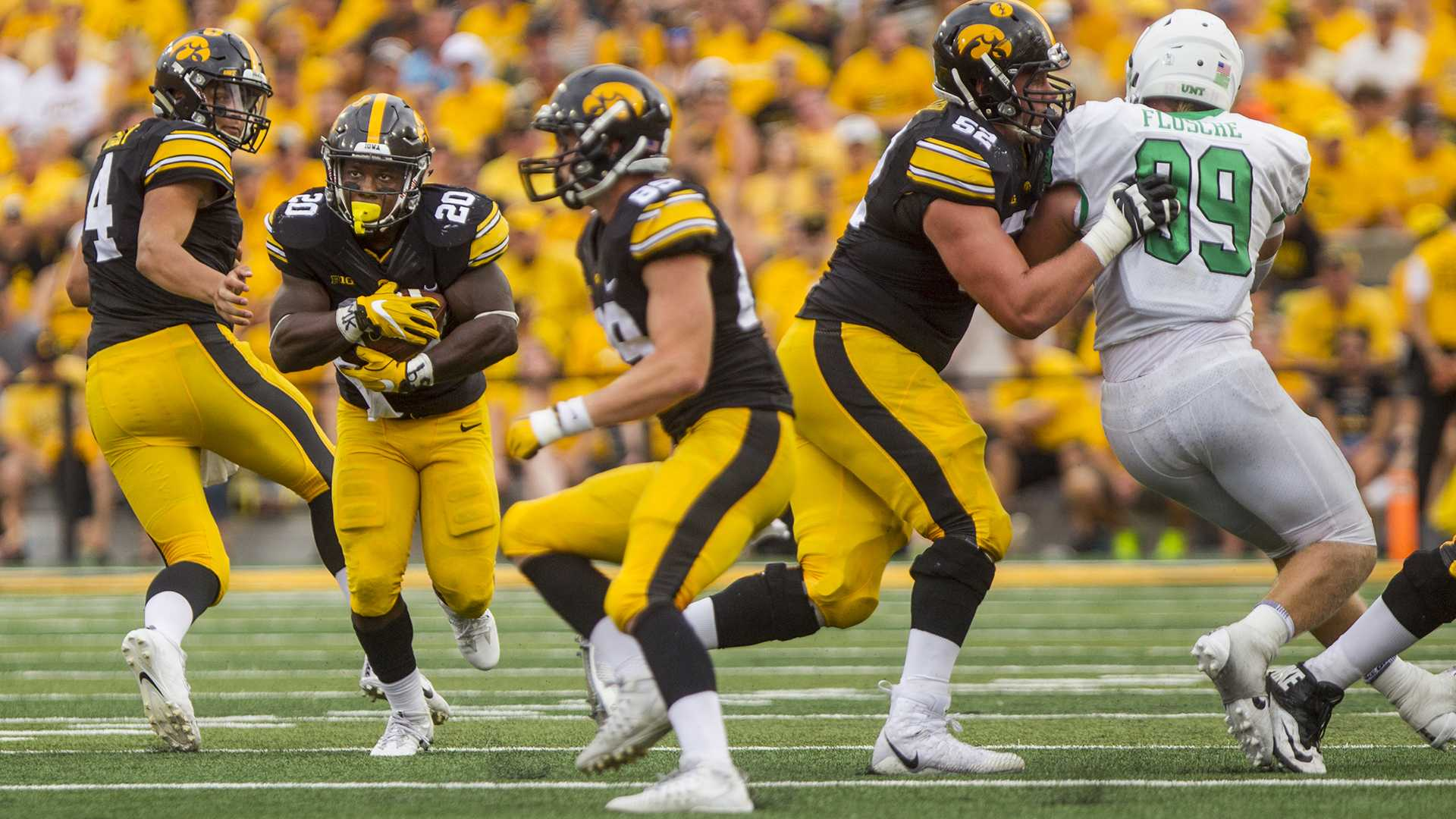 Iowa's James Butler carries the ball during the game between Iowa and North Texas at Kinnick Stadium on Saturday Sept. 16, 2017. Iowa won 31-14. (Nick Rohlman/The Daily Iowan)