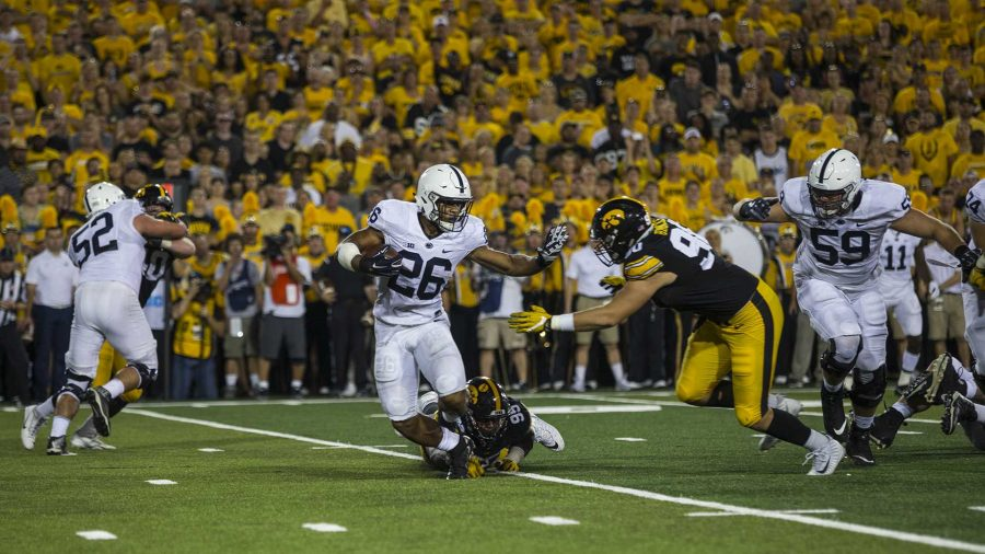 Penn+State%E2%80%99s+Saquon+Barkley+carries+the+ball+during+Iowa%E2%80%99s+game+against+Penn+State+in+Kinnick+Stadium+on+Sept.+23.+Barkley+set+a+Penn+State+school+record+with+358+all-purpose+yards.+Penn+State+defeated+Iowa%2C+21-19%2C+on+a+last-second+touchdown+pass.+%28Nick+Rohlman%2FThe+Daily+Iowan%29