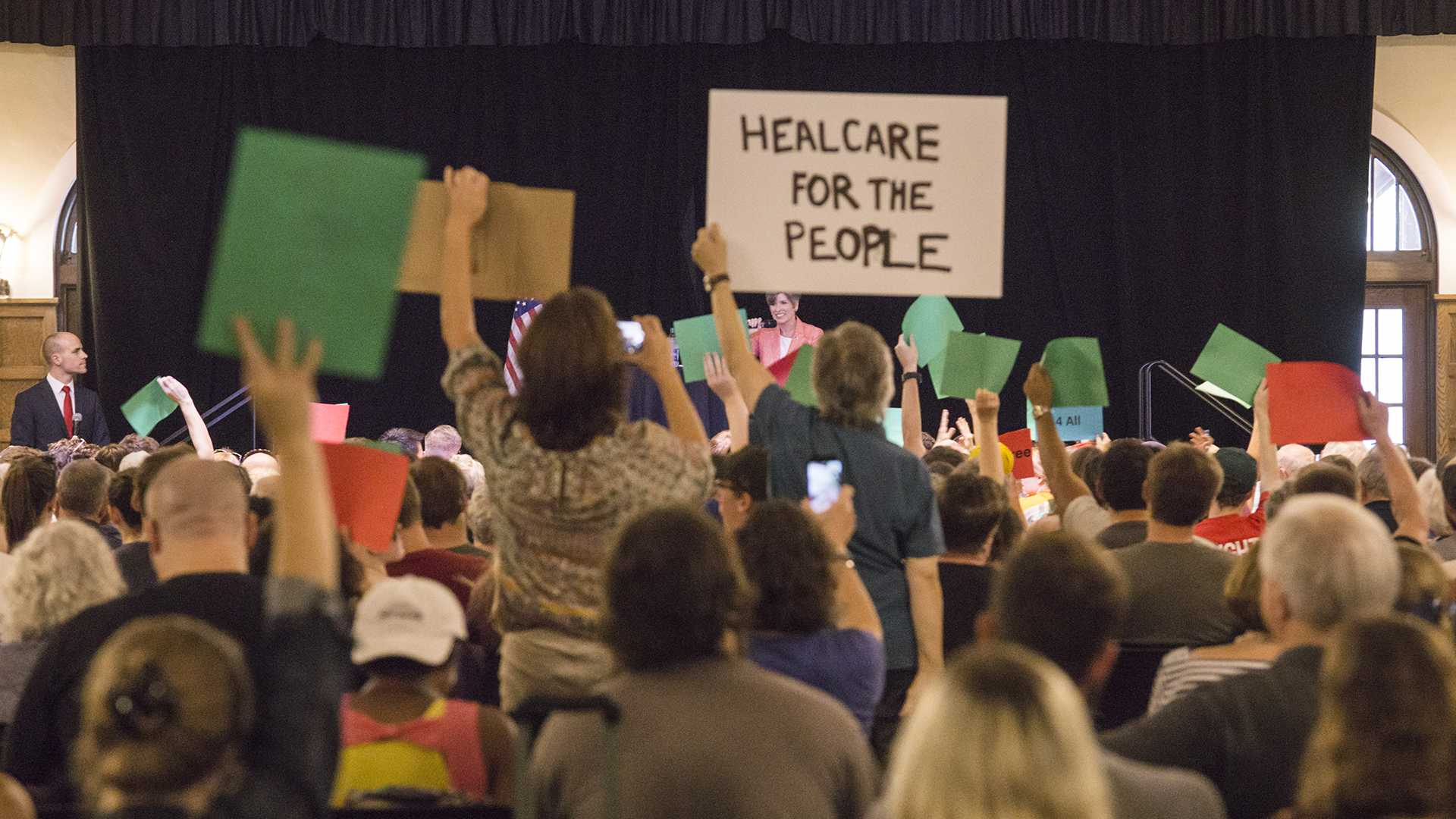 Attendees display their signs in protest to Sen. Joni Ernst's stance on the Graham-Cassidy bill at a Town Hall meeting in the Iowa Memorial Union on Friday, Sept. 22, 2017. (James Year/The Daily Iowan)