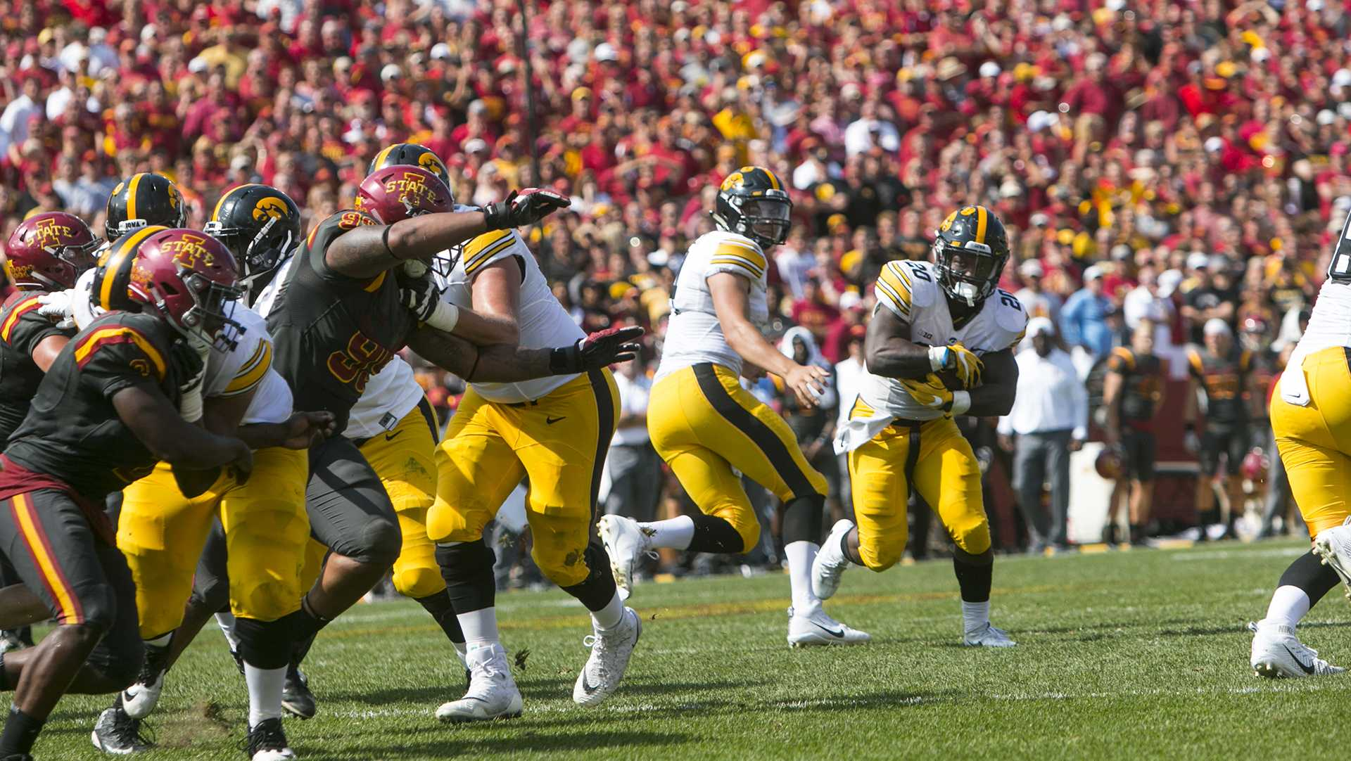 Iowa running back James Butler takes a handoff during the Iowa/Iowa State game for the Cy-Hawk trophy in Jack Trice Stadium on Saturday, Sept. 9, 2017. The Hawkeyes defeated the Cyclones, 44-41, in overtime.(Joseph Cress/The Daily Iowan)