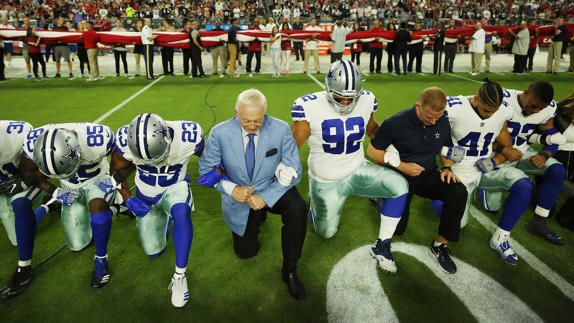 Dallas Cowboys players and staff including owner Jerry Jones and head coach Jason Garrett all take a knee before the singing of the National Anthem prior to the start of a game against the Arizona Cardinals at University of Phoenix Stadium Monday, Sept. 25, 2017 in Glendale, Ariz. (Vernon Bryant/The Dallas Morning News/TNS)   NO MAGAZINE SALES MANDATORY CREDIT; NO SALES; INTERNET USE BY TNS CONTRIBUTORS ONLY