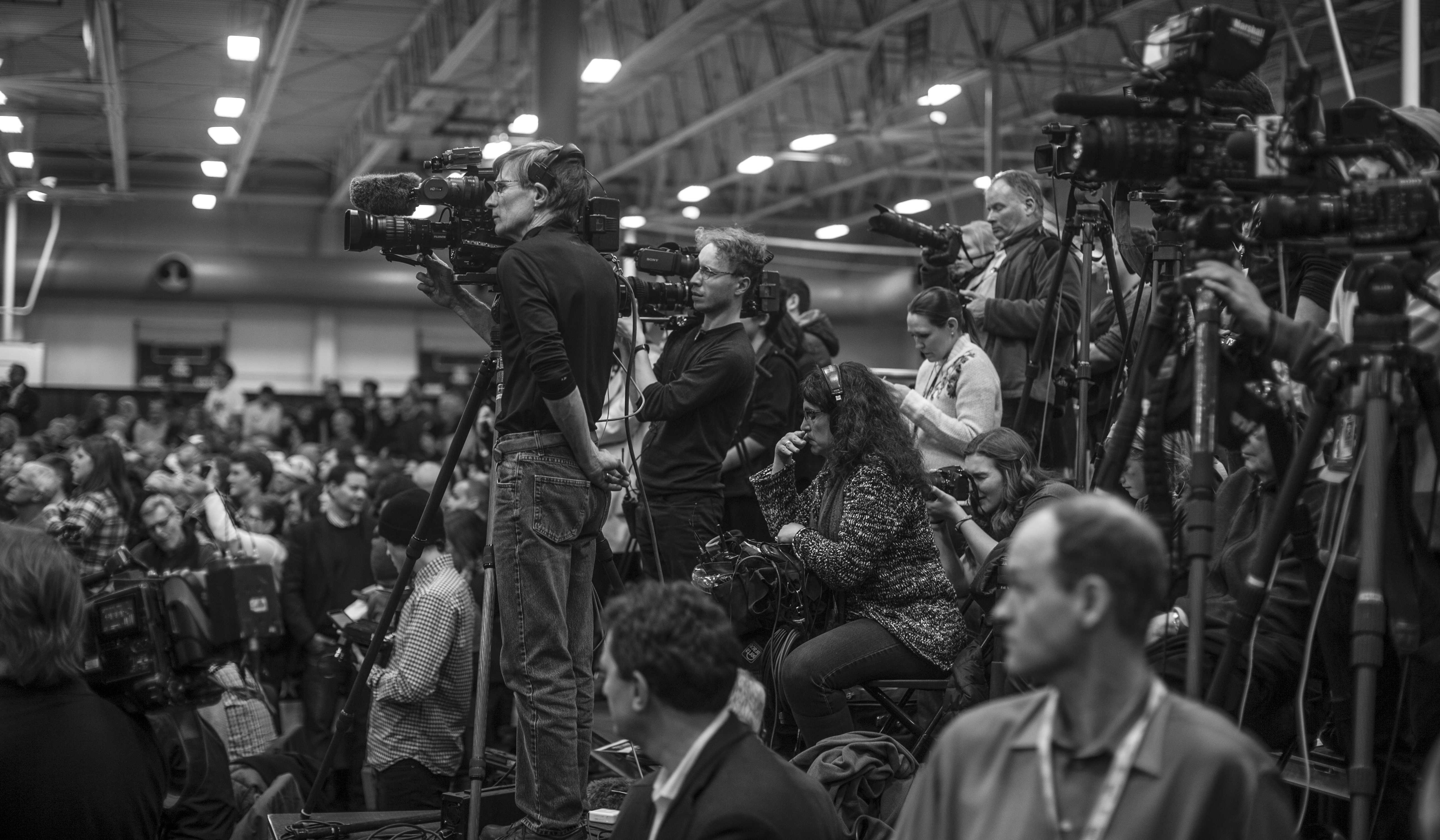 Media outlets cover Donald Trump's speech from the press booth at the University Field House on Tuesday, Jan 26, 2016.  Donald Trump and Ted Cruz are currently tied in Iowa. (The Daily Iowan/Jordan Gale)