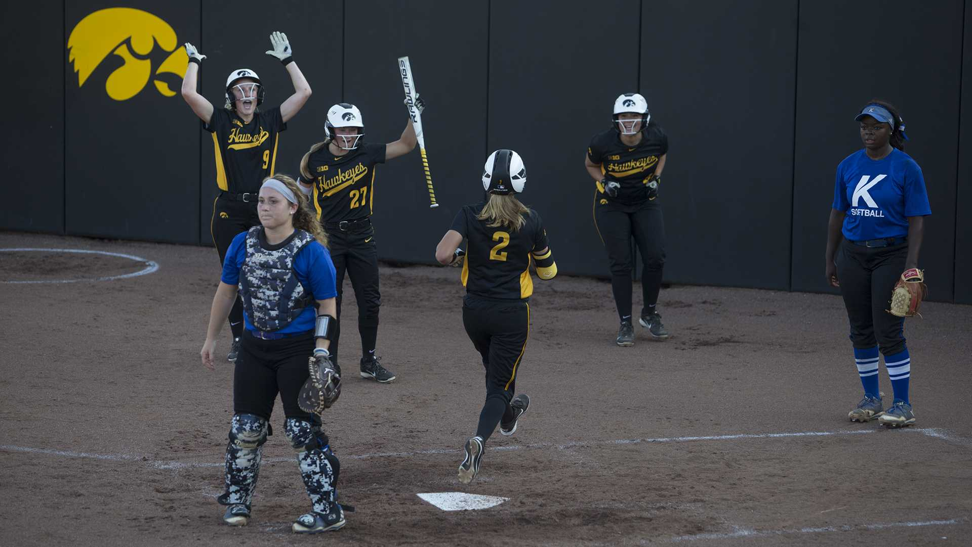 Hawks cheer as Aralee Bogar makes last of many home runs in a row at the Pearl Field Hawkeye Softball complex on Friday, Sept. 22, 2017. Hawkeyes defeated Kirkwood Community College 5-3. (Ashley Morris/The Daily Iowan)
