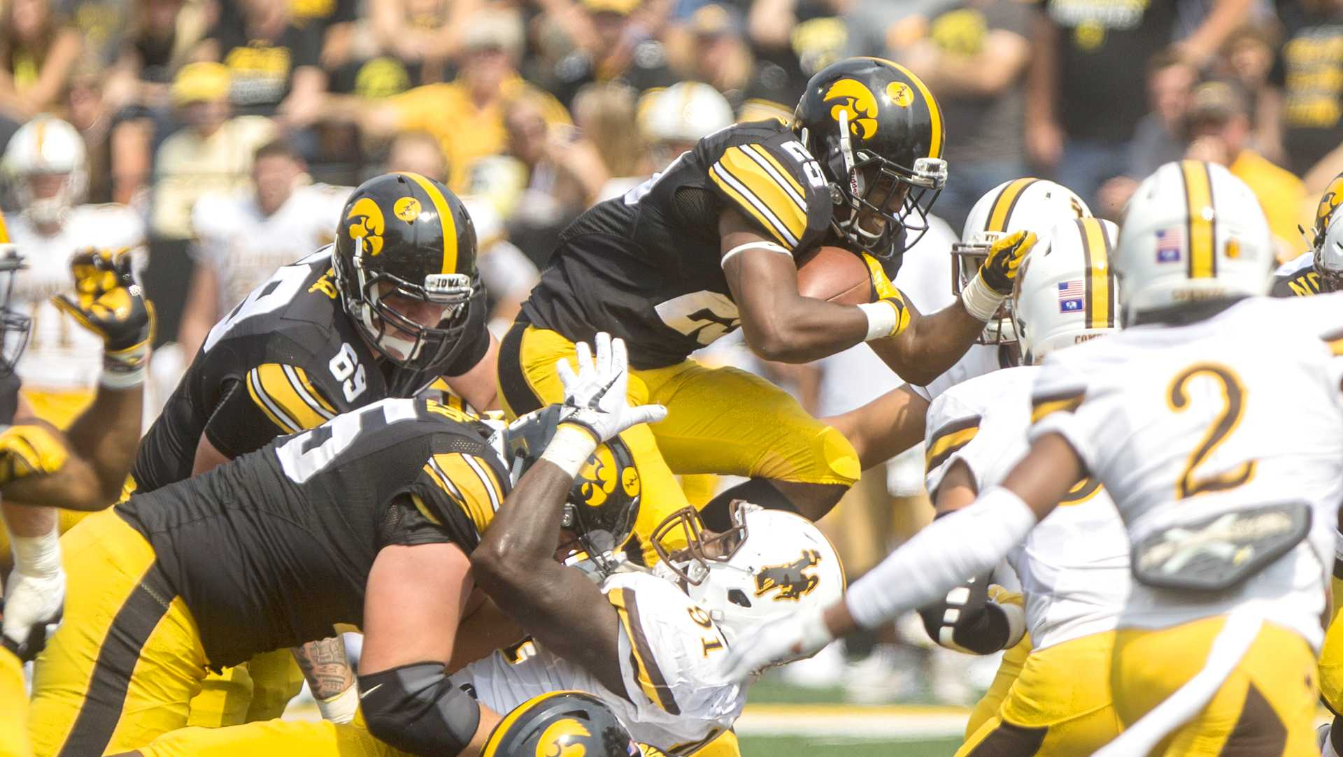 Iowa running back Akrum Wadley dives over the Wyoming defense during the season opener against Wyoming on Saturday, Sep. 2, 2017. The Hawkeyes went on to defeat the Cowboys, 24-3. (Ben Smith/The Daily Iowan)