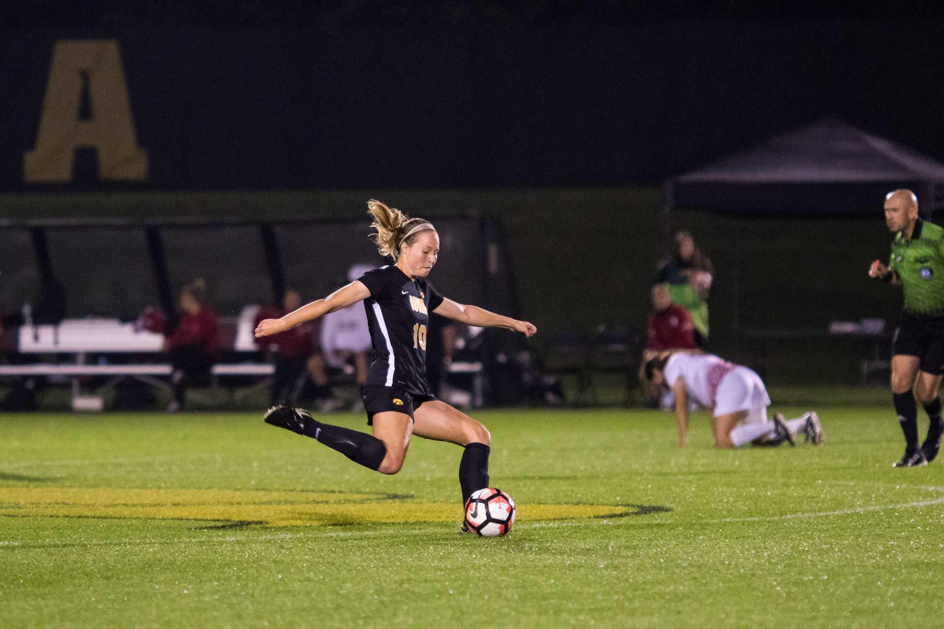 Iowa's Natalie Winters kicks the ball during the Iowa/Rutgers soccer game on Thursday, Oct. 5, 2017. Iowa won the match 1-0. (David Harmantas/The Daily Iowan)