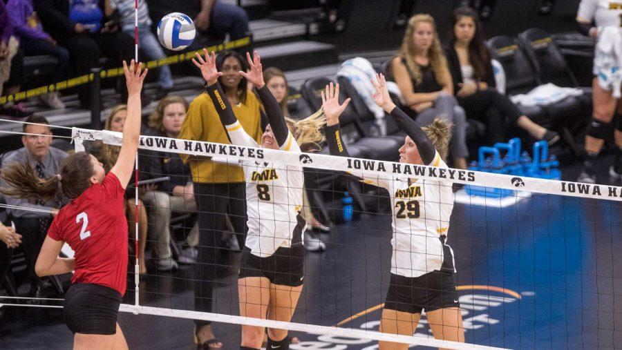 Players+battle+at+the+net+during+the+Iowa%2FNebraska+volleyball+match+on+Saturday%2C+Oct.+7%2C+2017.+Nebraska+defeated+Iowa+3-0.+%28David+Harmantas%2FThe+Daily+Iowan%29