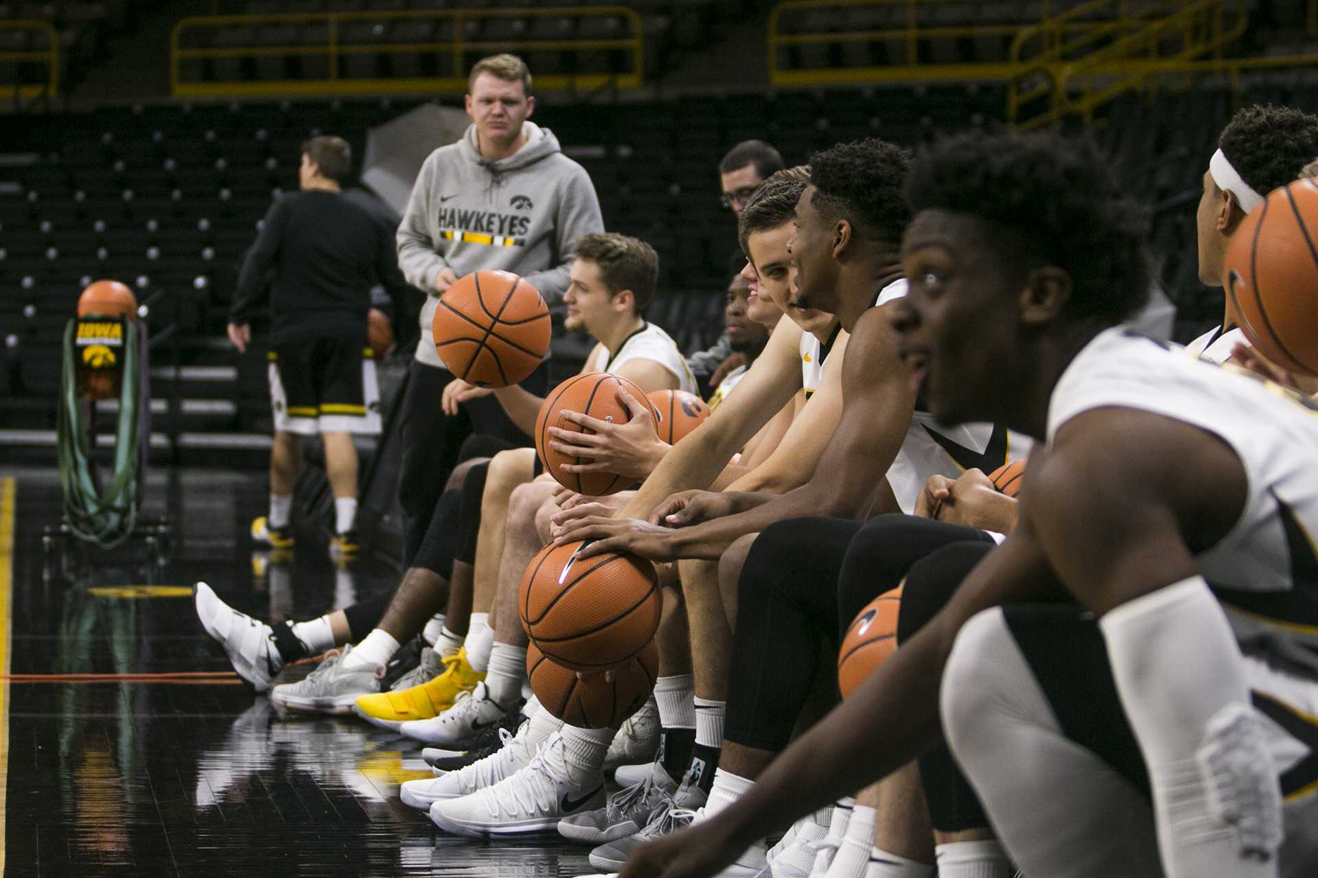 Iowa sit on the bench during men's basketball media day in Carver-Hawkeye Arena on Monday, Oct. 16, 2017. The Hawkeyes open up their season with an exhibition game against William Jewell College on Friday, Oct. 27. at 7 p.m. in Carver. (Joseph Cress/The Daily Iowan)