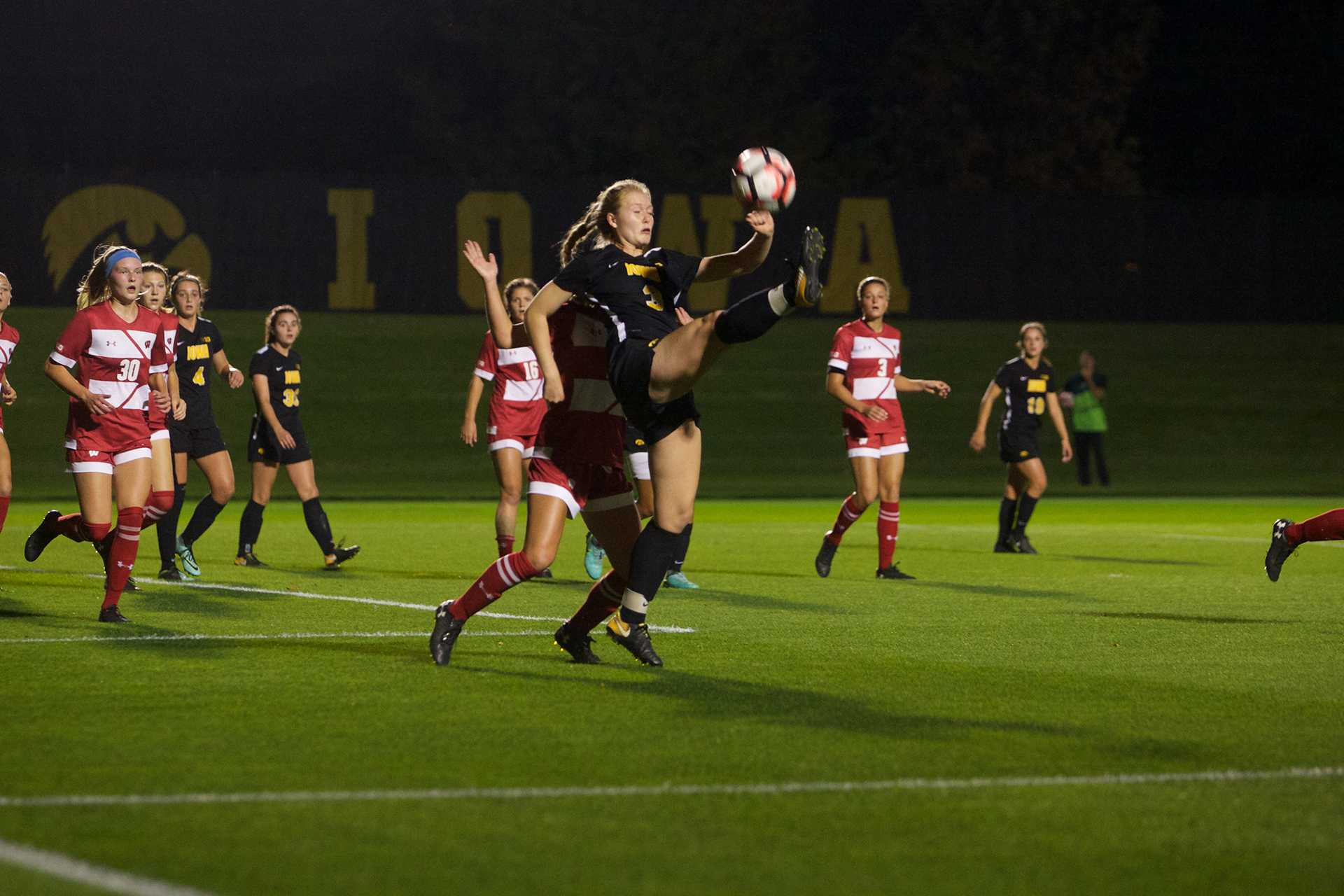 Hawkeye midfielder Morgan Kemerling attempts a half bicycle kick in the box at the Iowa Soccer Complex in Iowa City on Saturday, October 21, 2017. The Hawkeyes fell to the Badgers 3-0 (Paxton Corey/The Daily Iowan)