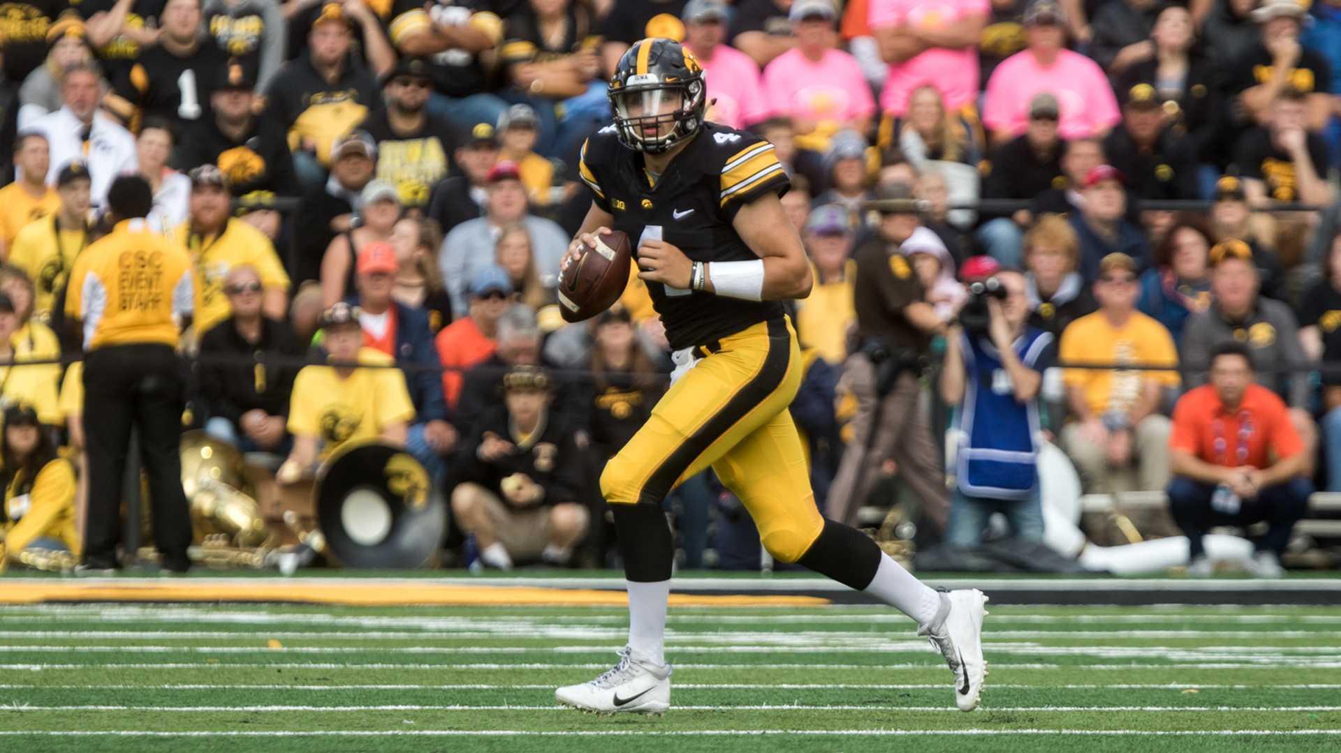 Iowa quarterback Nate Stanley drops back to pass during the Iowa/Illinois football game on Saturday, Oct. 7, 2017. Iowa won the game 45-16. (David Harmantas/The Daily Iowan)