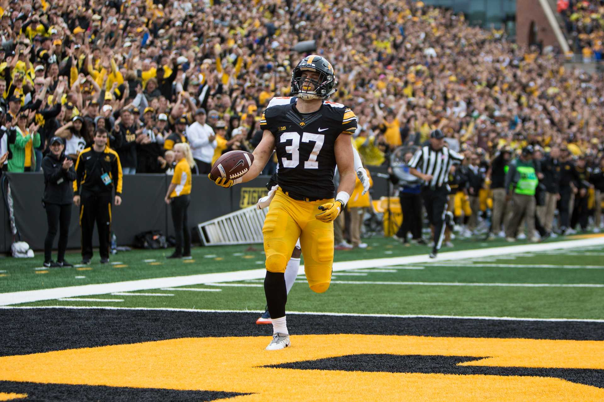 Iowa defensive back Brandon Snyder crosses the goal line after returning an interception for an 89 yard touchdown during the Iowa/Illinois football game on Saturday, 7 Oct. 2017. Iowa won the game 45 to 16. (David Harmantas/The Daily Iowan)