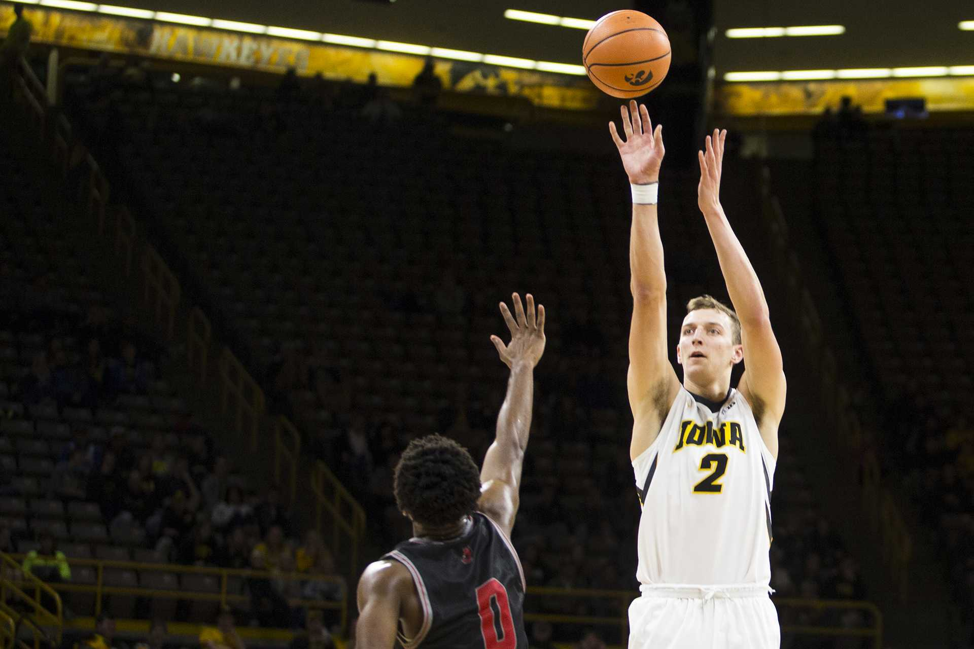 Iowa forward Jack Nunge shoots over William Jewell guard Keith Hayes during a men's basketball exhibition game between Iowan and William Jewell College in Carver-Hawkeye Arena on Friday, Oct. 27, 2017. The Hawkeyes defeated the Cardinals, 105-81. (Joseph Cress/The Daily Iowan)