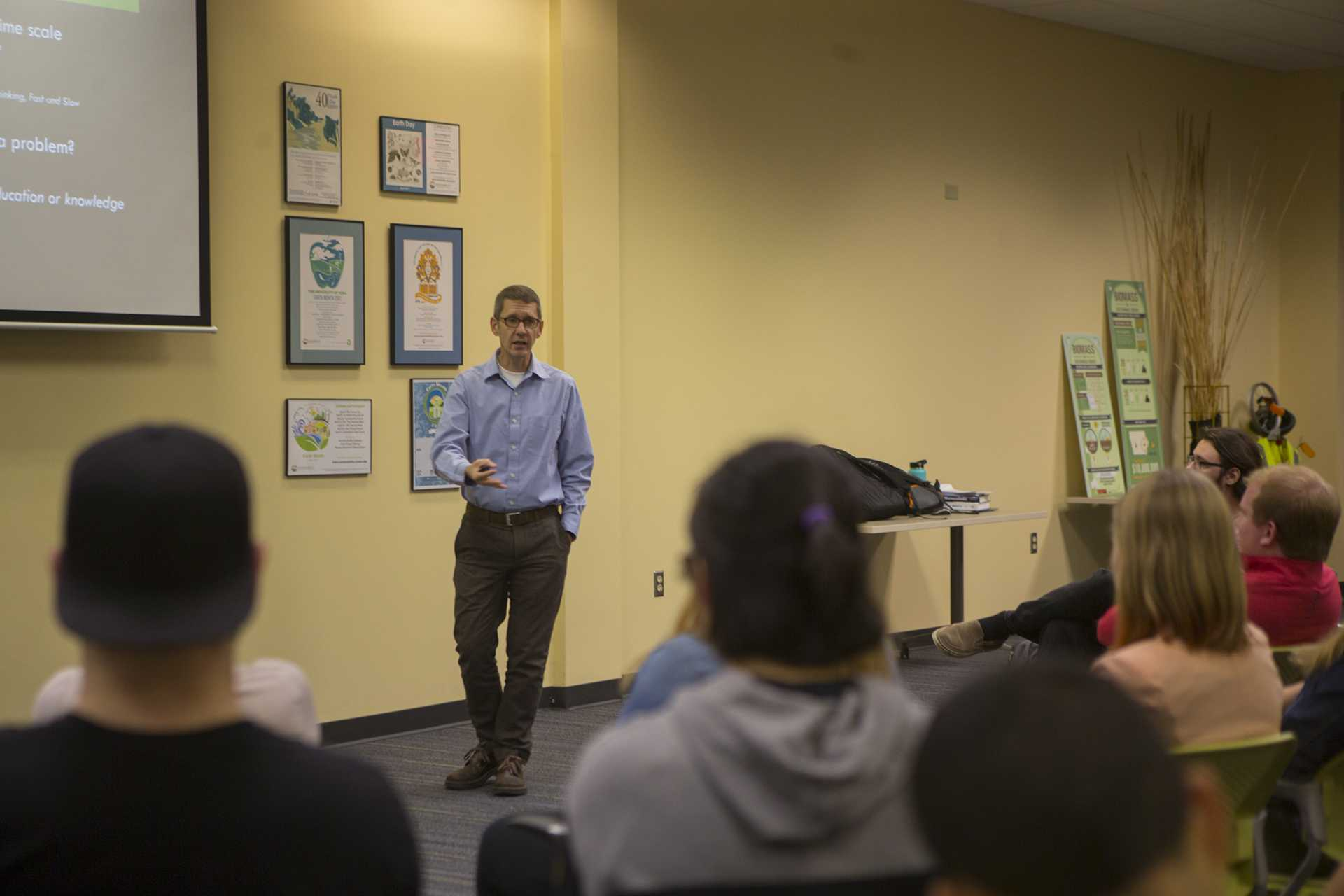 UI psychology professor Shaun Vecera speaks during How Psychology Can Change the Planet in the UI Office of Sustainability on Thursday, Oct. 19, 2017. The event was part of a month;y Sustainable Lecture series hosted by the UI Environmental Coalition. (Lily Smith/The Daily Iowan)