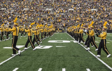 Marching Band forms hand to 'wave' to UI Children's Hospital