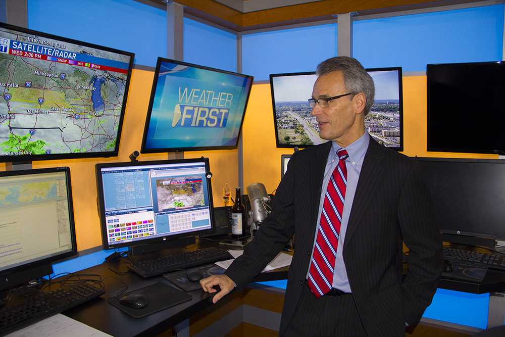 KGAN chief meteorologist Terry Swails looks at computer monitors showing a rainstorm moving into eastern Iowa at KGAN studio on Oct. 4. Swails, who has been a meteorologist for 41 years, has some reservations about discussing climate change in his weather forecasts because of
