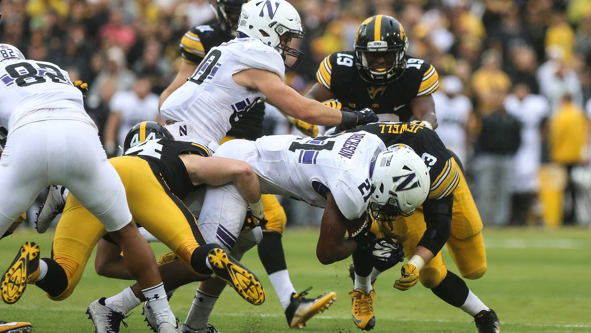 Northwestern running back Justin Jackson crashes into Iowa outside linebacker Josey Jewell during the Iowa v. Northwestern game at Kinnick Stadium on Saturday, Oct. 1, 2016. The Hawkeyes fell to the Wildcats 38-31. (The Daily Iowan/Anthony Vazquez)
