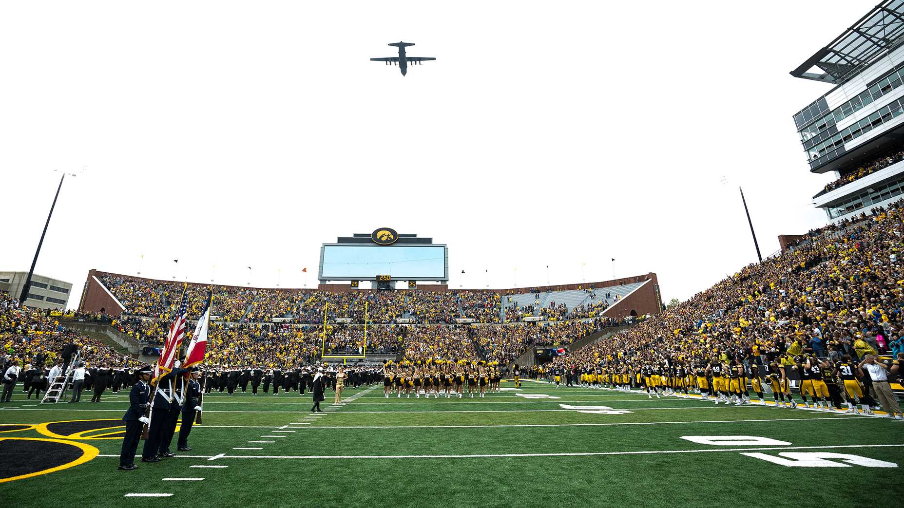 A C-130 flies over Kinnick Stadium before the start of the game between Iowa and Illinois on Saturday, Oct. 7, 2017. (Dave Harmantas/The Daily Iowan)