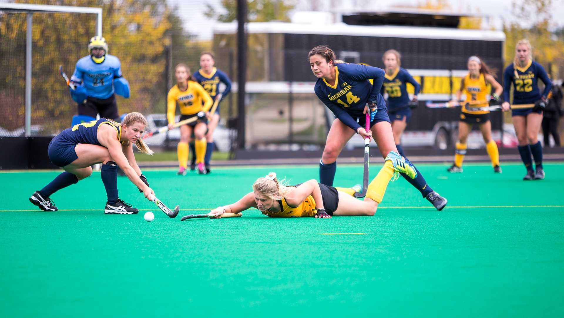 Iowa field hockey player Ellie Holley crashes to the ground during a match against the Michigan Wolverines on Sunday, Oct. 15, 2017.  The Wolverines defeated the Hawkeyes 3-2. (David Harmantas/The Daily Iowan)