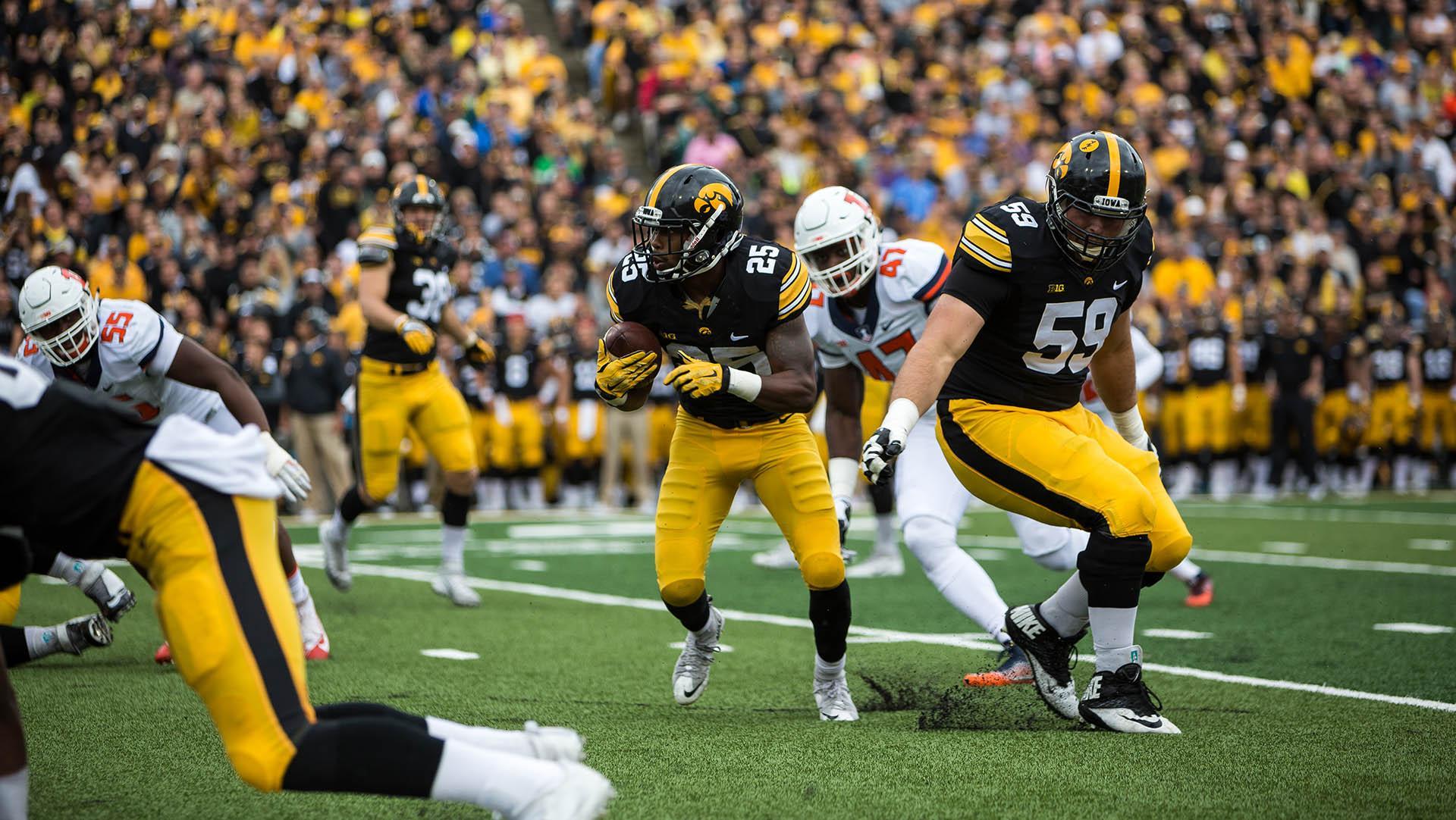 Iowa running back Akrum Wadley runs the ball during the Iowa/Illinois football game on Saturday, 7 Oct. 2017. Iowa won the game 45-16. (David Harmantas/The Daily Iowan)