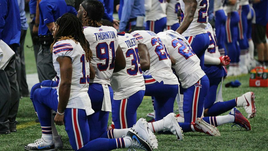 Many+of+the+Buffalo+Bill+players+kneel+on+the+sidelines+for+the+national+anthem+before+the+game+with+the+Atlanta+Falcons+in+the+land+of+the+free+on+Oct.+1%2C+2017+in+Atlanta.+%28Curtis+Compton%2FAtlanta+Journal-Constitution%2FTNS%29
