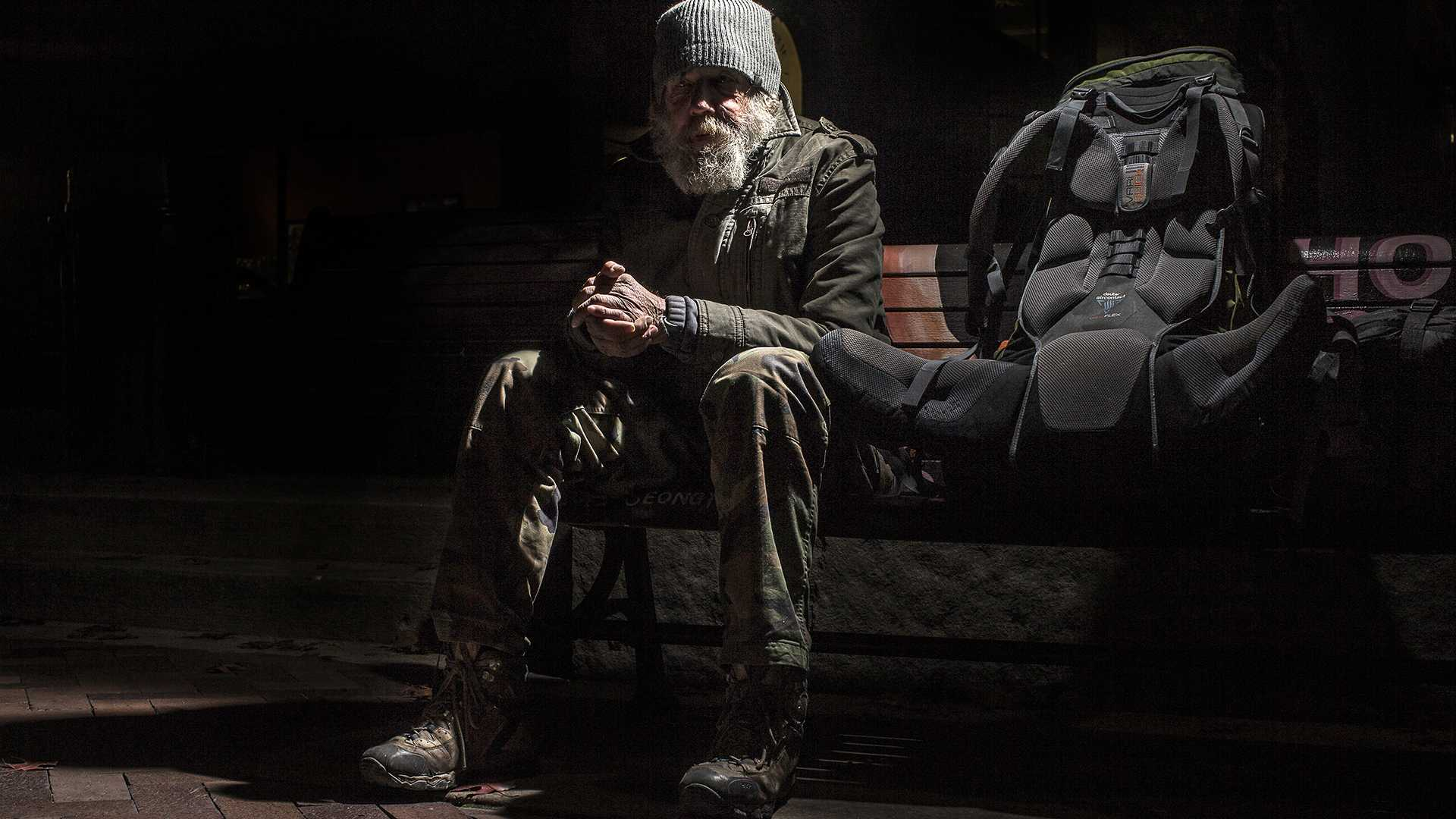 FILE - Ronal Alan Rarey, sits and listens to a singer in the Ped Mall on Monday, Nov. 9, 2015. Rarey is a homeless Vietnam veteran, he has been without a home for nearly seven years. (The Daily Iowan/file)