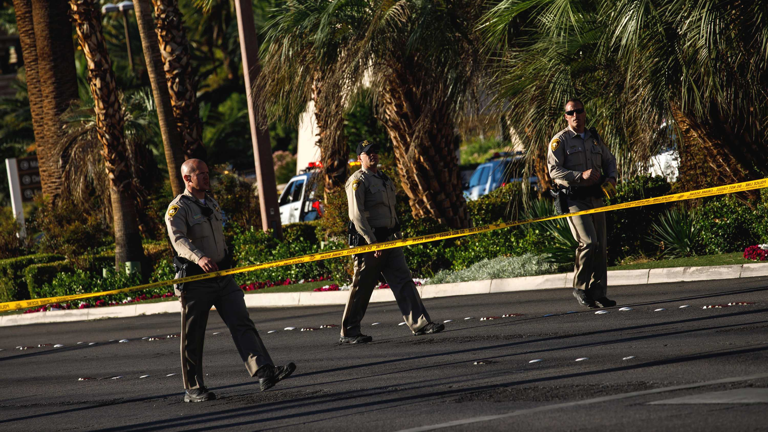 Law enforcement officers cordon off a crime scene after a gunman opened fire from an upper story of Mandalay Bay resort on a country music festival across the street on the Las Vegas Strip on Sunday night, leaving at least 58 dead and more than 500 injured, in Las Vegas, Nevada, on Oct. 2, 2017. (Marcus Yam/Los Angeles Times/TNS)